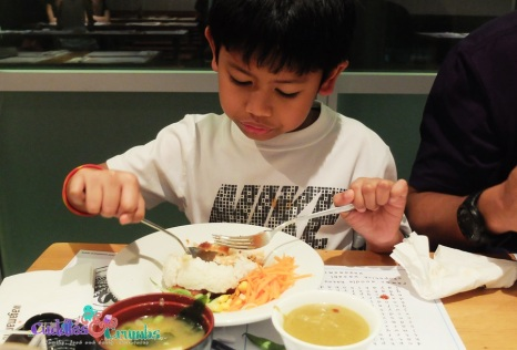 LittleMan so serious eating his Mini Chicken Katsu.