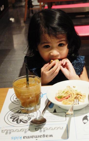 LittleMiss dinner spread of duck gyoza, mini chicken yakisoba and fresh juice.