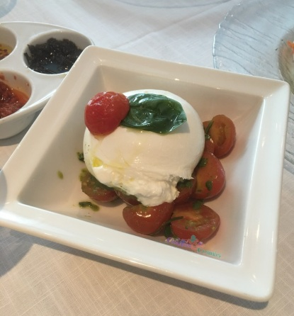 BiCE Burratina with cherry tomato and pesto sauce